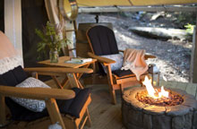 glampground firepit with chairs